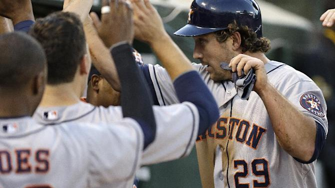 Astros hold on to edge A's, 5-4