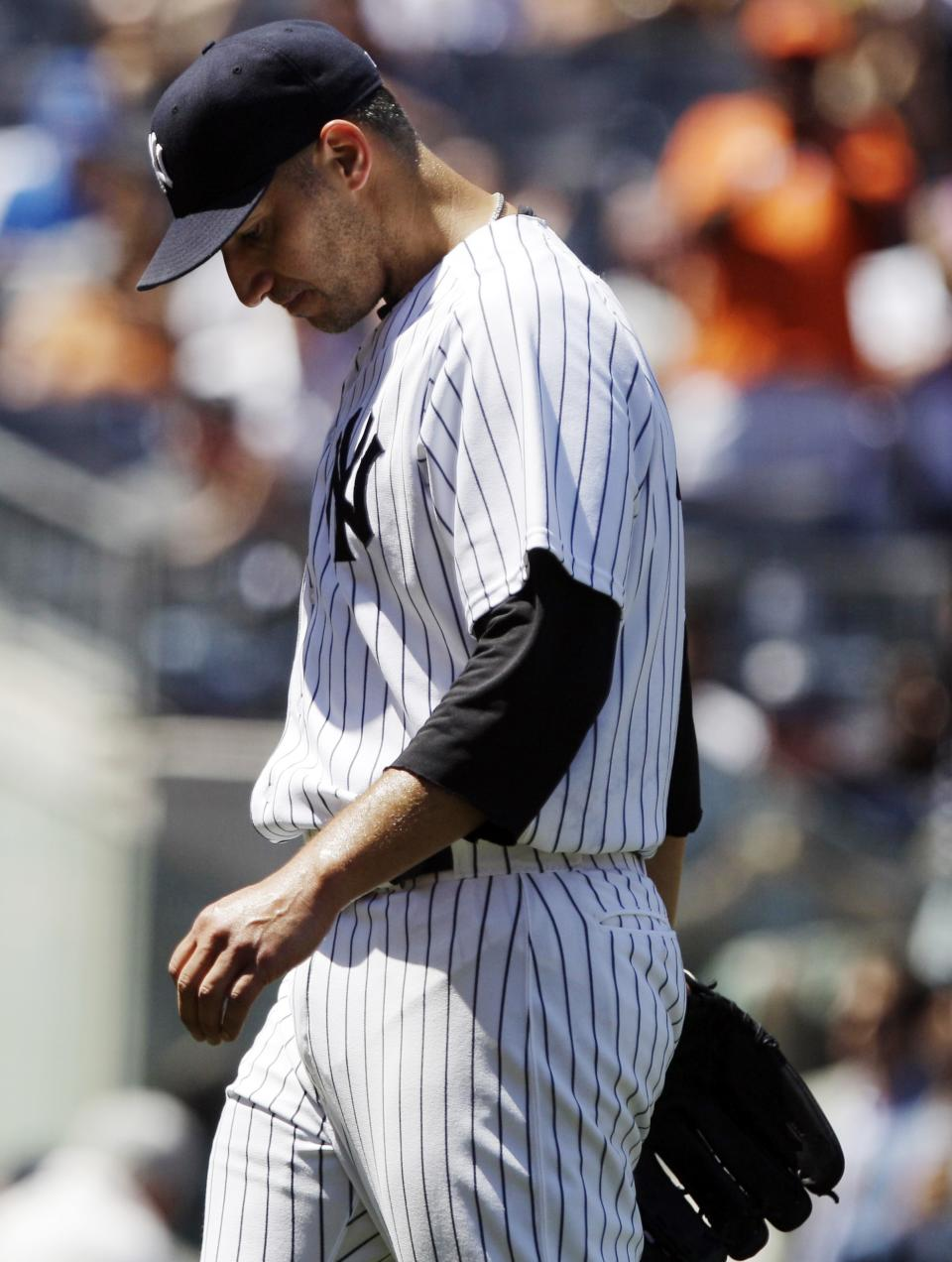 New York Yankees' Andy Pettitte leaves the game during the fifth inning of a baseball game against the Cleveland Indians Wednesday, June 27, 2012, in New York. (AP Photo/Frank Franklin II)