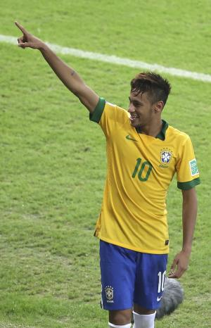 Brazil's Neymar celebrates after winning 2-1 at the soccer Confederations Cup semifinal match between Brazil and Uruguay at the Mineirao stadium in Belo Horizonte, Brazil, Wednesday, June 26, 2013. (AP Photo/Andre Penner)