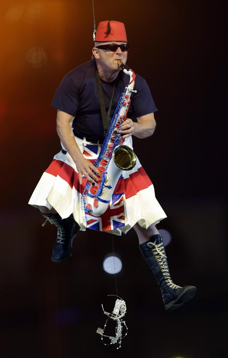 Lee Thompson of Madness performs during the Closing Ceremony at the 2012 Summer Olympics, Sunday, Aug. 12, 2012, in London. (AP Photo/Charlie Riedel)