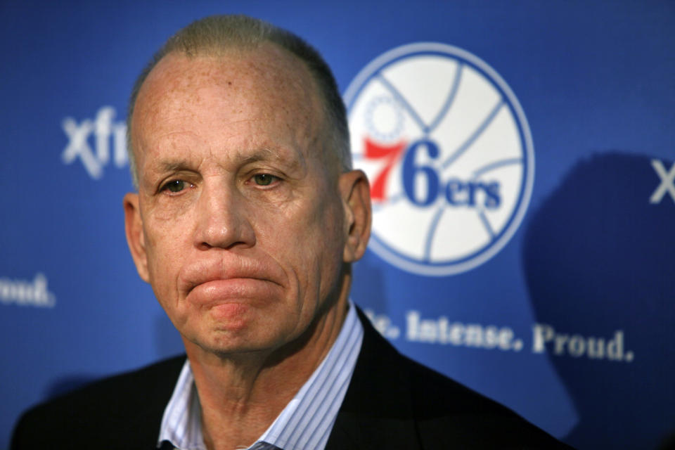 Doug Collins grimaces during a news conference where he announced his resignation as head coach of the Philadelphia 76ers NBA basketball team, Thursday, April 18, 2013 in Philadelphia. (AP Photo/Joseph Kaczmarek)