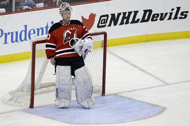 New Jersey Devils goalie Martin Brodeur stands in goal late in the third period of an NHL hockey game against the Boston Bruins in Newark, N.J., Sunday, April 13, 2014. The Devils won 3-2. (AP Photo/Mel Evans)