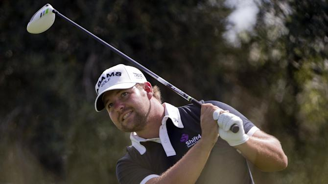 Ryan Moore tees off on the ninth hole during the first round of the Justin Timberlake Shriners Hospitals for Children Open golf tournament, Thursday, Oct. 4, 2012, in Las Vegas. Moore finished at 10-under par for the round. (AP Photo/Julie Jacobson)