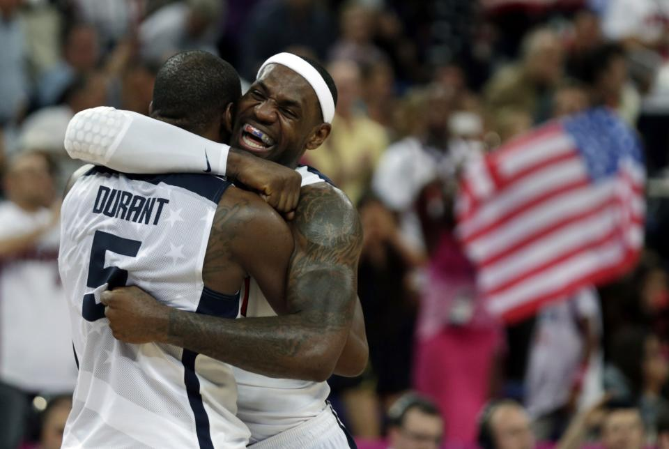 United States' LeBron James and Kevin Durant react during the men's gold medal basketball game against Spain at the 2012 Summer Olympics, Sunday, Aug. 12, 2012, in London. USA won 107-100. (AP Photo/Charles Krupa)