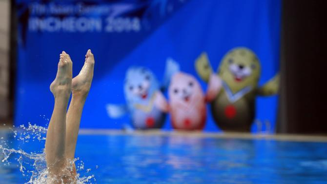 Member of Macau's synchronised swimming team takes part in a practice session ahead of 17th Asian Games in Incheon