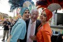 "Oscar Goodman poses for photos with two showgirls before kicking off a car show at the Fremont Street Experience, 105Friday, May 17, 2013, in Las Vegas. The former Las Vegas mayor branded the city with a larger than life persona. And now he's branded himself again with a memoir. In ""Being Oscar--From Mob Lawyer to Mayor of Las Vegas, Only in America,"" Goodman tells all from his days as a lawyer representing members of the mob to his three terms as the ""happiest mayor in the universe."" (AP Photo/Julie Jacobson)"