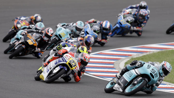 Great Britain's Danny Kent rides his Honda as he leads the pack during the Moto3 race of the Argentina's Motorcycle Grand Prix at the Termas de Rio Hondo circuit in Argentina,  Sunday, April 19, 2015. (AP Photo/Natacha Pisarenko)