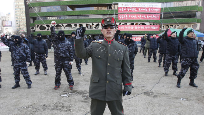 A veteran of South Korean Headquarters of Intelligence Detachment (HID),  in a North Korean military uniform,  shouts a slogan with his former comrades during a rally against South Korean government giving support to pro-North Korean groups in South Korea near the City Hall in Seoul, South Korea, Friday, Jan. 25, 2013. South Korea's President Park Geun-hye is strongly urging North Korea to refrain from conducting a nuclear test that could only worsen the tensions on the Korean Peninsula in the wake of a provocative long-range rocket launch in December, envoy Rhee In-je told The Associated Press and selected news outlets in Davos, Switzerland. (AP Photo/Ahn Young-joon) (AP Photo/Ahn Young-joon)