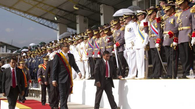 Ecuadorean President Rafael Correa arrives to attend a military ceremony at the Eloy Alfaro military school in Quito