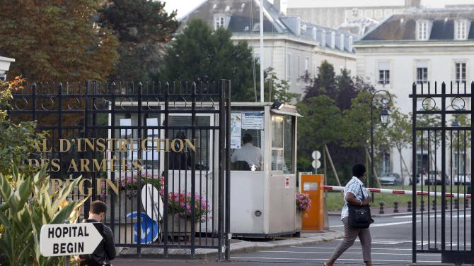 A woman walks past the entrance of the military Hospital Begin in Saint-Mande, eastern Paris
