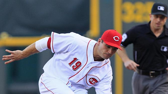 Cincinnati Reds first baseman Joey Votto fields a ground ball hit by Pittsburgh Pirates' Alex Presley in the first inning of a baseball game, Thursday, June 7, 2012, in Cincinnati. Votto tagged Presley out at first. (AP Photo/Al Behrman)