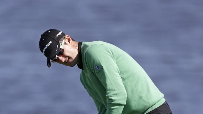Justin Rose, of England, putts on the sixth green during the final round of the Arnold Palmer Invitational golf tournament, Monday, March 25, 2013, in Orlando, Fla. (AP Photo/John Raoux)