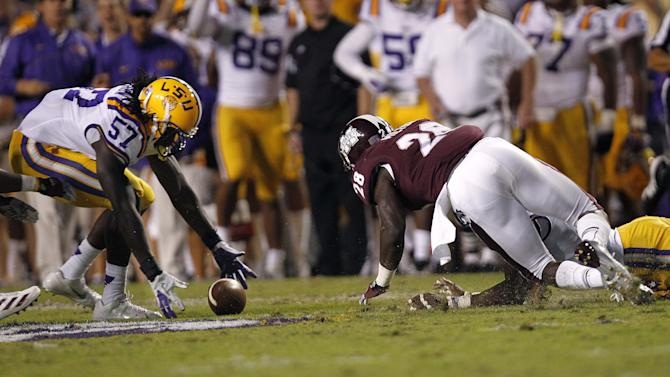 LSU linebacker Lamin Barrow (57) recovers a fumble ahead of Mississippi State running back Derrick Milton (28) in the first half of their NCAA college football game in Baton Rouge, La., Saturday, Nov. 10, 2012. (AP Photo/Gerald Herbert)