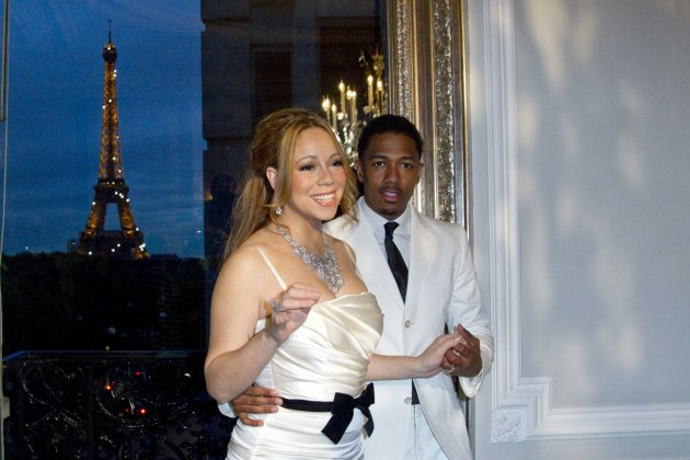 Musician Carey and husband Cannon attend a photo call near the Eiffel Tower before their vow renewal ceremony in Paris