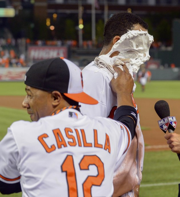 Orioles' Dickerson gets shaving cream on his face from teammate Casilla during a post-game interview in Baltimore