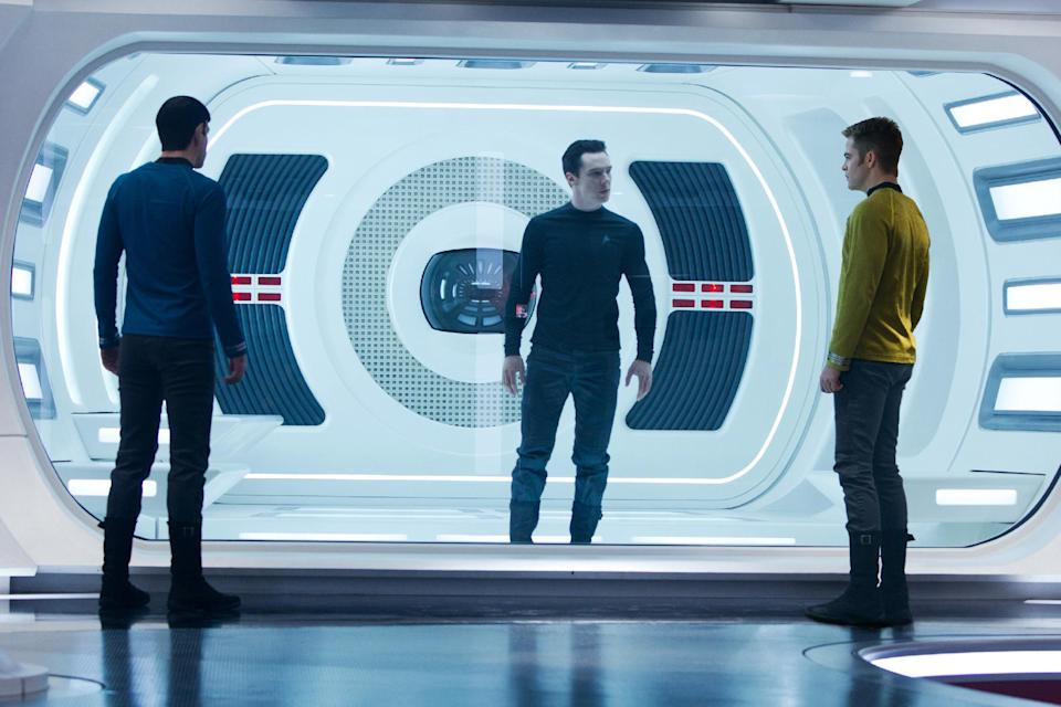 "This undated publicity film image released by Paramount Pictures shows, from left, Zachary Quinto, as Spock, Benedict Cumberbatch as John Harrison, and Chris Pine as Kirk, in a scene in the movie, ""Star Trek Into Darkness,"" from Paramount Pictures and Skydance Productions.  (AP Photo/Paramount Pictures, Zade Rosenthal)"