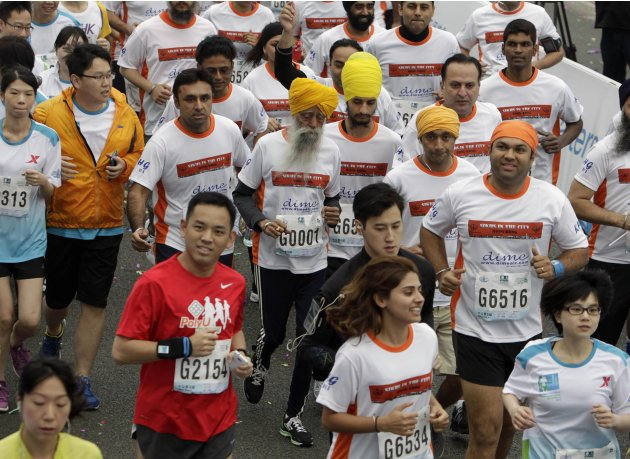 British Indian marathon runner Singh and compatriot runners jog at the start of a 10-kilometer race of the Hong Kong Marathon