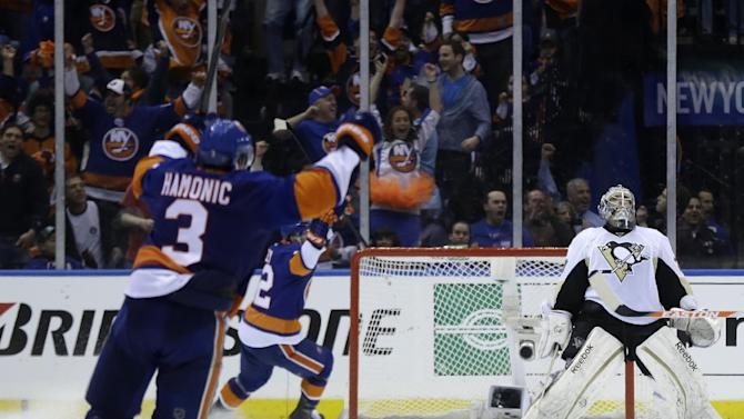 Pittsburgh Penguins goalie Marc-Andre Fleury, right, reacts after New York Islanders' John Tavares scored to tie the game during the third period of Game 3 of an NHL hockey Stanley Cup first-round playoff series on Sunday, May 5, 2013, in Uniondale, N.Y. (AP Photo/Seth Wenig)
