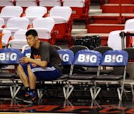 New York Knicks guard Jeremy Lin during a training session ahead of his team&#39;s game against the Miami Heat on May 9. Lin says he is erring on the side of caution by not rushing back into the NBA playoffs so he can give his surgically repaired knee more time to heal