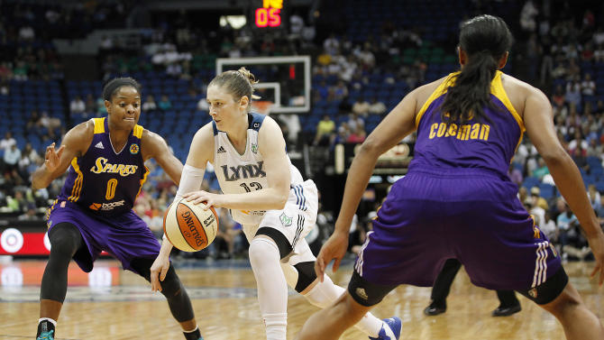 Minnesota Lynx guard Lindsay Whalen, center, drives the ball between Los Angeles Sparks guard Alana Beard (0) and guard Marissa Coleman, right, in the second half of a WNBA basketball game on Wednesday, Sept. 4, 2013, in Minneapolis. The Lynx won 83-74. (AP Photo/Stacy Bengs)