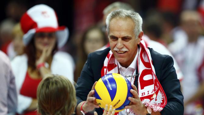 Polish media mogul Solorz-Zak plays with a ball after the semifinal match between Poland and Germany at the FIVB Volleyball Men's World Championship Poland 2014 at Spodek Arena in Katowice