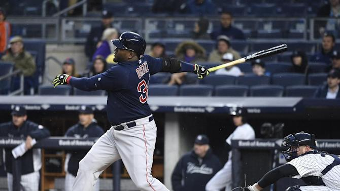 Boston Red Sox designated hitter David Ortiz hits a two-run home run off of New York Yankees starting pitcher Michael Pineda as Brian McCann catches for the Yankees in the first inning of a baseball game, Friday, May 6, 2016, in New York. (AP Photo/Kathy Kmonicek)