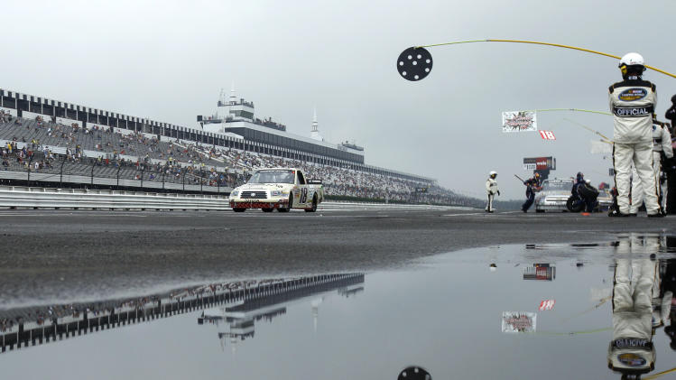 Driver Kyle Busch drives down pit road during the NASCAR Camping World Truck Series auto race, Sunday, Aug. 7, 2011, at Pocono Raceway in Long Pond, Pa. (AP Photo/Matt Slocum)