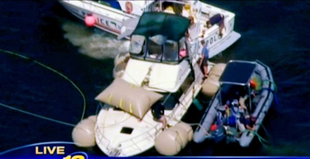 This image made from video and provided by News 12 Long Island shows the Kandi Won from the air on Oyster Bay, off the shore of New York&#39;s Long Island, Wednesday, July 11, 2012. The yacht that capsized and sank on July 4, killing three children, has been lifted from the bottom of the bay and will be brought to shore. (AP Photo/News 12 Long Island) MANDATORY CREDIT