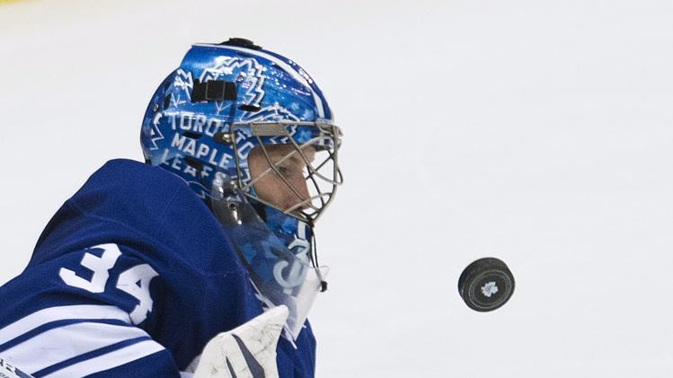 Toronto Maple Leafs goalie James Reimer eyes the puck while playing against the Boston Bruins during second period NHL hockey playoff action in Toronto on Sunday, May 12, 2013. (AP Photo/The Canadian Press, Nathan Denette)