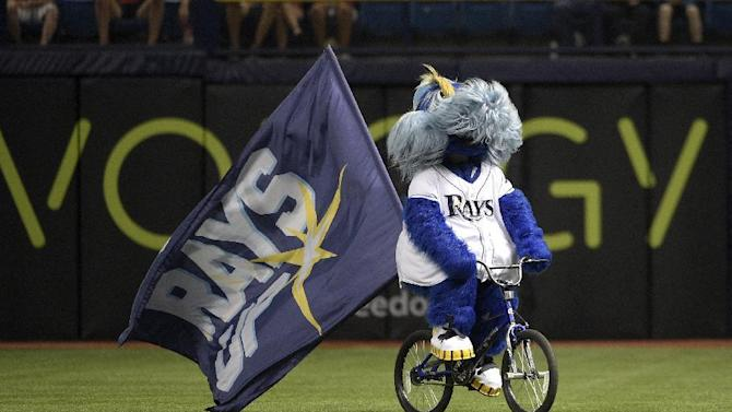 Tampa Bay Rays mascot Raymond rides a bicycle through the outfield before a baseball game against the Cleveland Indians in St. Petersburg, Fla., Tuesday, June 30, 2015. (AP Photo/Phelan M. Ebenhack)