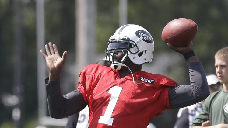 New York Jets' Michael Vick (1) throws a pass at practice during NFL football training camp Saturday, July 26, 2014, in Cortland, N.Y