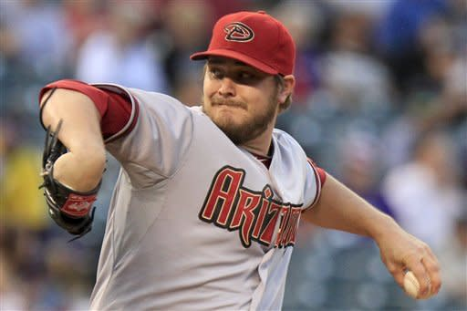 Miley wins 16th as Diamondbacks top Rockies 15-5