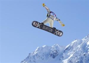 U.S. snowboarder White takes some air off a jump during a slopestyle snowboard training at the 2014 Sochi Winter Olympics in Rosa Khutor