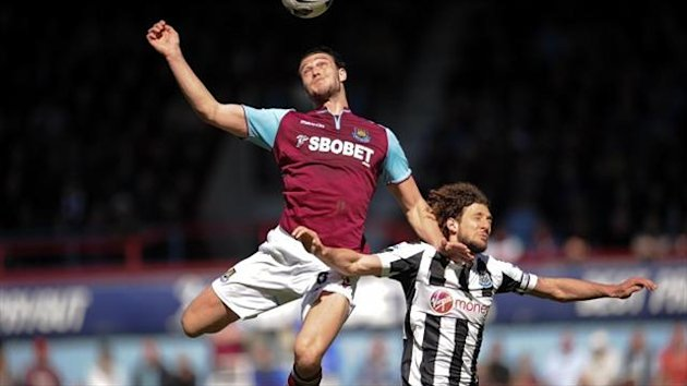 Liverpool striker Andy Carroll, left, has spent the season on loan at West Ham