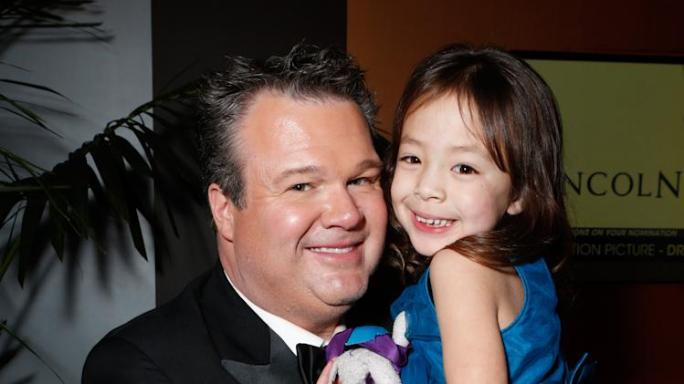 Actors Eric Stonestreet, left, and Aubrey Anderson-Emmons attend the Fox Golden Globes Party on Sunday, January 13, 2013, in Beverly Hills, Calif. (Photo by Todd Williamson/Invision for Fox Searchlight/AP Images)