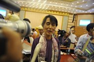 Myanmar opposition leader Aung San Suu Kyi speaks to media representatives in Naypyidaw earlier this month. Suu Kyi will make a speech in Oslo next month to accept the Nobel Peace Prize she was awarded in 1991, as part of her first trip outside Myanmar in 24 years, the Nobel Committee announced