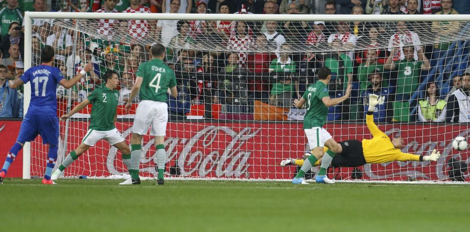 Croatia's Mario Mandzukic scores  the opening goal during the Euro 2012 soccer championship Group C match between the Republic of Ireland and Croatia in Poznan, Poland, Sunday, June 10, 2012. (AP Photo/Darko Bandic)