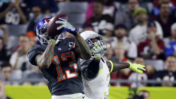 New York Giants' Odell Beckham catches a pass in front of Arizona Cardinals' Antonio Cromartie during the first half of the NFL Football Pro Bowl Sunday, Jan. 25, 2015, in Glendale, Ariz. (AP Photo/Charlie Riedel)