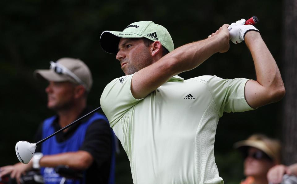 Sergio Garcia, of Spain, watches a tee shot from the second tee during the third round of the Wyndham Championship golf tournament in Greensboro, N.C., Saturday, Aug. 18, 2012. (AP Photo/Gerry Broome)