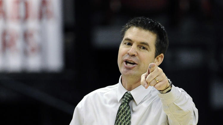 Colorado State coach Ryun Williams calls to his team during the second half of an NCAA college basketball game against Utah State in the Mountain West Conference women's tournament on Tuesday, March 11, 2014, in Las Vegas. (AP Photo/David Becker)