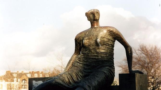 "FILE - In this June. 3, 1996 file photo of Henry Moore's sculpture ""Draped, Seated Woman"". A cash-strapped authority in east London says it's selling a valuable Henry Moore statue over the objections of leading British arts figures including director Danny Boyle. London's Tower Hamlets Council said late Wednesday, Nov. 7, 2012, that ""Draped Seated Woman,"" which stood for years on a public housing complex in the city's East End, would be sold ""due to the massive government cuts we are facing."" (AP Photo/PA, File) UNITED KINGDOM OUT  NO SALES  NO ARCHIVE"