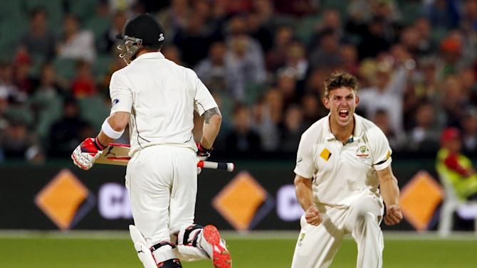 Australia's Mitchell Marsh celebrates after he dismissed New Zealand's captain Brendon McCullum LBW for 20 runs during the second day of the third cricket test match at the Adelaide Oval, in South Australia