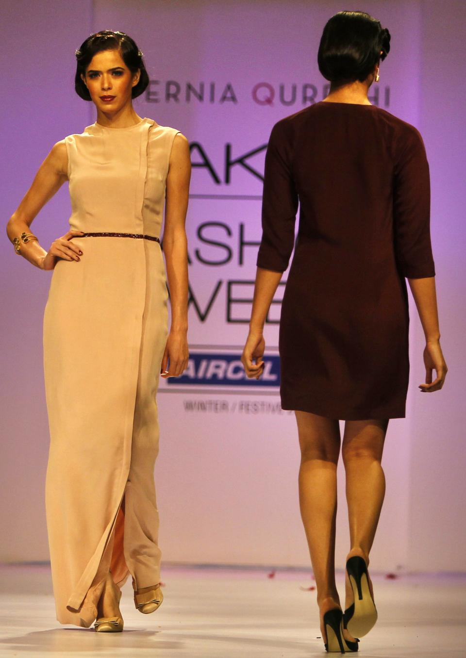 Indian models display a creation by Pernia Qureshi during the Lakme Fashion Week in Mumbai, India, Saturday, Aug. 4, 2012. (AP Photo/Rafiq Maqbool)