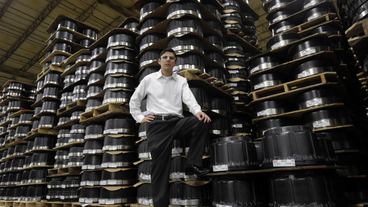 "In this Friday, Jan. 11, 2013, photo, Webb Wheel Products President Duane Ricketts is pictured in front a portion of their inventory of brake drums in Cullman, Ala. ""Everyone is waiting for the unemployment rate to drop, but I don't know if it will much,"" Ricketts says. ""Companies in the recession learned to be more efficient, and they're not going to go back."" (AP Photo/Dave Martin)"