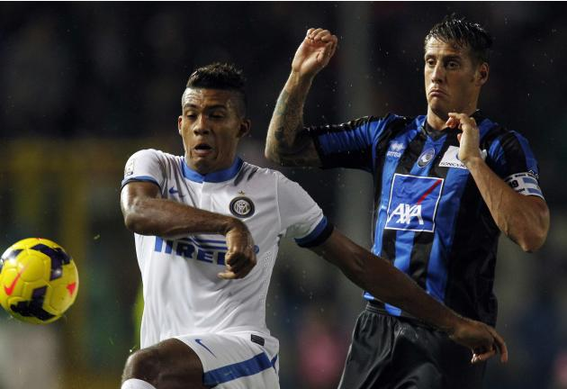 Inter Milan's Juan Jesus fights for the ball with Atalanta's German Denis during their Italian Serie A soccer match at Atleti Azzurri d'Italia stadium in Bergamo