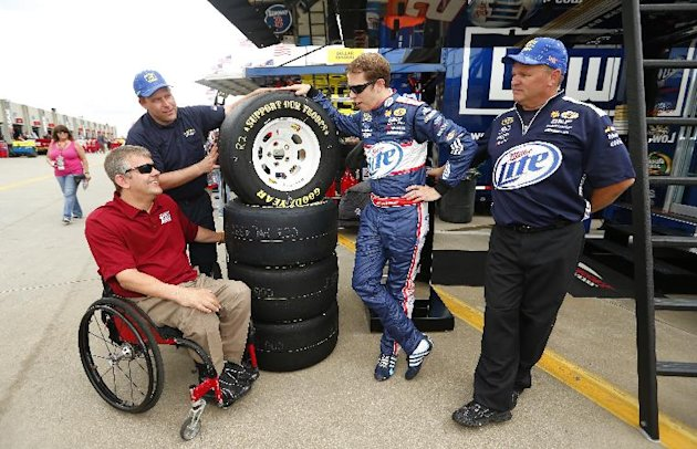 IMAGE DISTRIBUTED FOR GOODYEAR- Brad Keselowski, right center, driver of the #2 Miller Lite Ford talks with Mike Savicki, left, Paralyzed Veterans of America member as Jim Davis, right, tire specialis