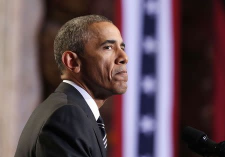 U.S. President Obama pause while speaking about immigration reform in Chicago