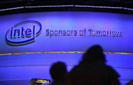 Showgoers visit the Intel booth on the first day of the Consumer Electronics Show (CES) in Las Vegas January 8, 2013. REUTERS/Rick Wilking