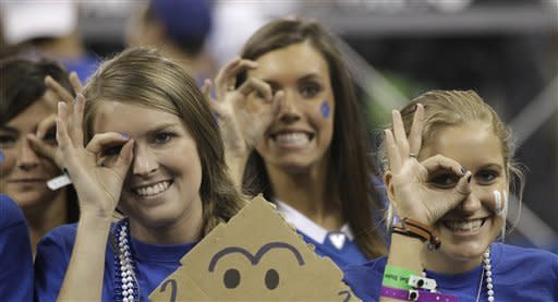 Fans burn couches, flip cars after Kentucky's win