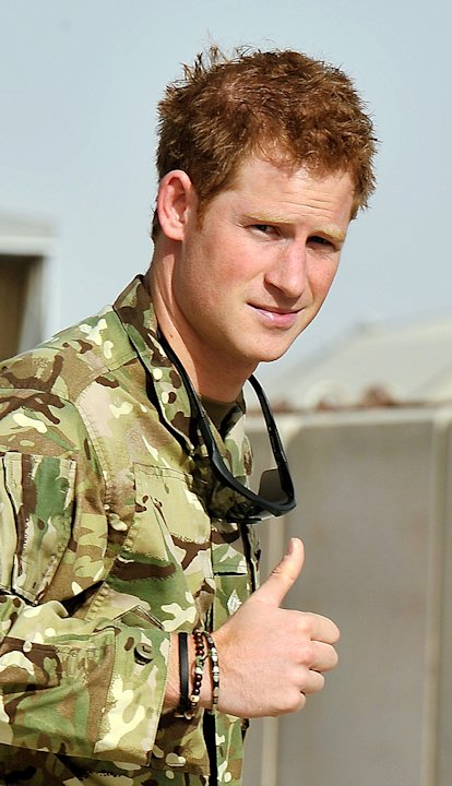 Britain's Prince Harry gives a thumbs up Friday Sept.  7, 2012 after he walked past the Apache flight-line at Camp Bastion in Afghanistan, where he will be operating from during his tour of duty a